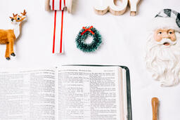 Open Bible with Commercial Christmas Items  image 5