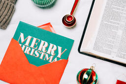 Open Bible with Commercial Christmas Items  image 9