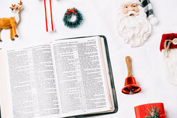 Open Bible with Commercial Christmas Items  image 4