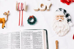 Open Bible with Commercial Christmas Items  image 2