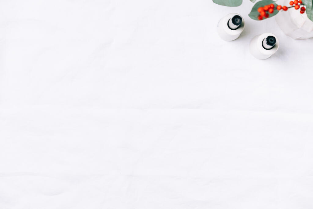 Christmas Florals and Taper Candles on a White Linen Tablecloth large preview