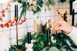 Woman Lighting a Candle  image 2