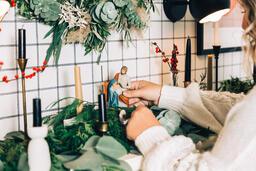 Woman Arranging the Nativity Scene  image 1