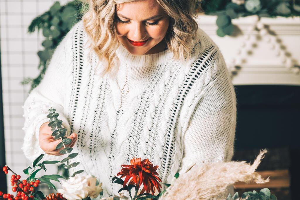 Woman Arranging Christmas Florals large preview