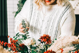 Woman Arranging Christmas Florals  image 2