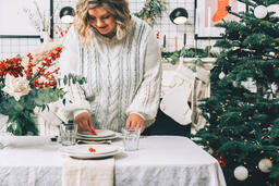 Woman Setting the Table for Christmas Dinner  image 2