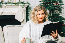 Woman Reading the Bible in Front of the Christmas Tree  image 3