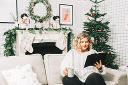 Woman Reading the Bible in Front of the Christmas Tree  image 1
