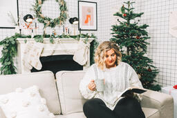 Woman Reading the Bible in Front of the Christmas Tree  image 2