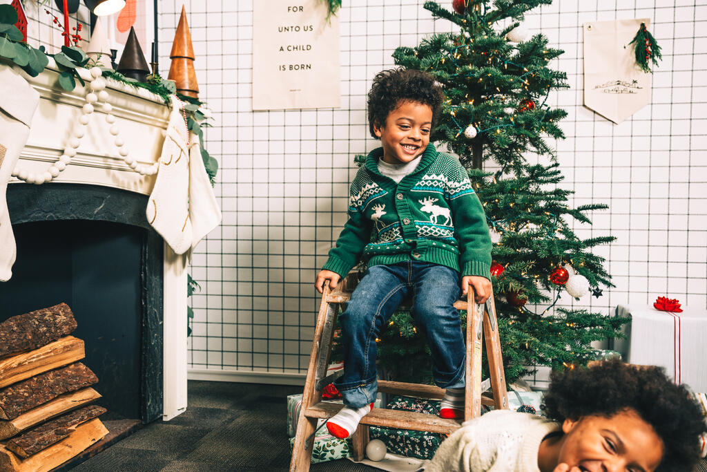 Kids Laughing Together in Front of the Christmas Tree large preview
