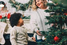 Child Decorating the Christmas Tree  image 4