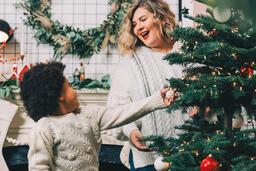 Child Decorating the Christmas Tree  image 1