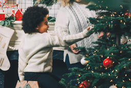 Child Decorating the Christmas Tree  image 7