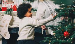 Child Decorating the Christmas Tree  image 2