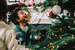 Kids Decorating the Christmas Tree Together  image 5