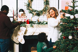 Family Decorating for Christmas Together  image 2