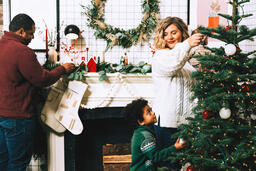 Family Decorating for Christmas Together  image 1