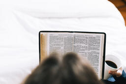 Husband and Wife Reading the Bible Together in Bed  image 1