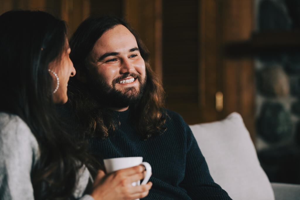 Husband and Wife Drinking Coffee and Laughing Together large preview