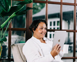 Woman Reading on a Tablet  image 1