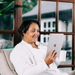 Woman Reading on a Tablet  image 2