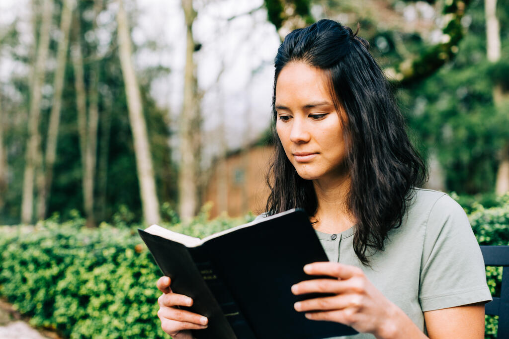 Woman Reading the Bible on the Patio Outside large preview