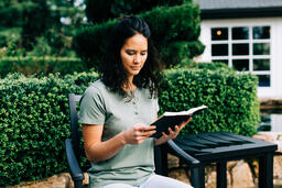 Woman Reading the Bible on the Patio Outside  image 2