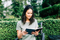 Woman Reading the Bible on the Patio Outside  image 1