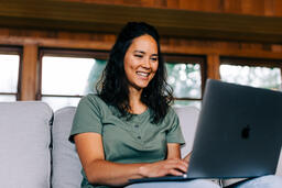 Woman Working on a Laptop and Smiling  image 3