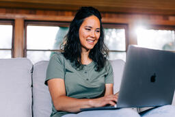 Woman Working on a Laptop and Smiling  image 5