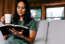 Woman Reading the Bible and Drinking Coffee  image 1