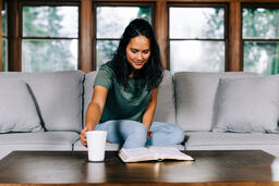 Woman Grabbing Her Cup of Coffee During Devotions  image 2