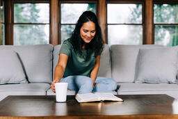 Woman Grabbing Her Cup of Coffee During Devotions  image 3