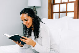 Woman Reading the Bible in Bed  image 2
