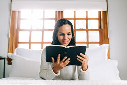 Woman Reading the Bible in Bed at Sunrise  image 5