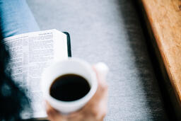 Woman Reading the Bible with a Cup of Coffee  image 1
