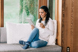 Woman Reading on a Tablet  image 3