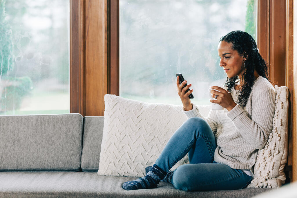 Woman Looking at Her Phone large preview