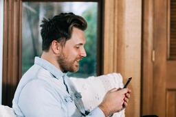 Man Looking at His Phone  image 1