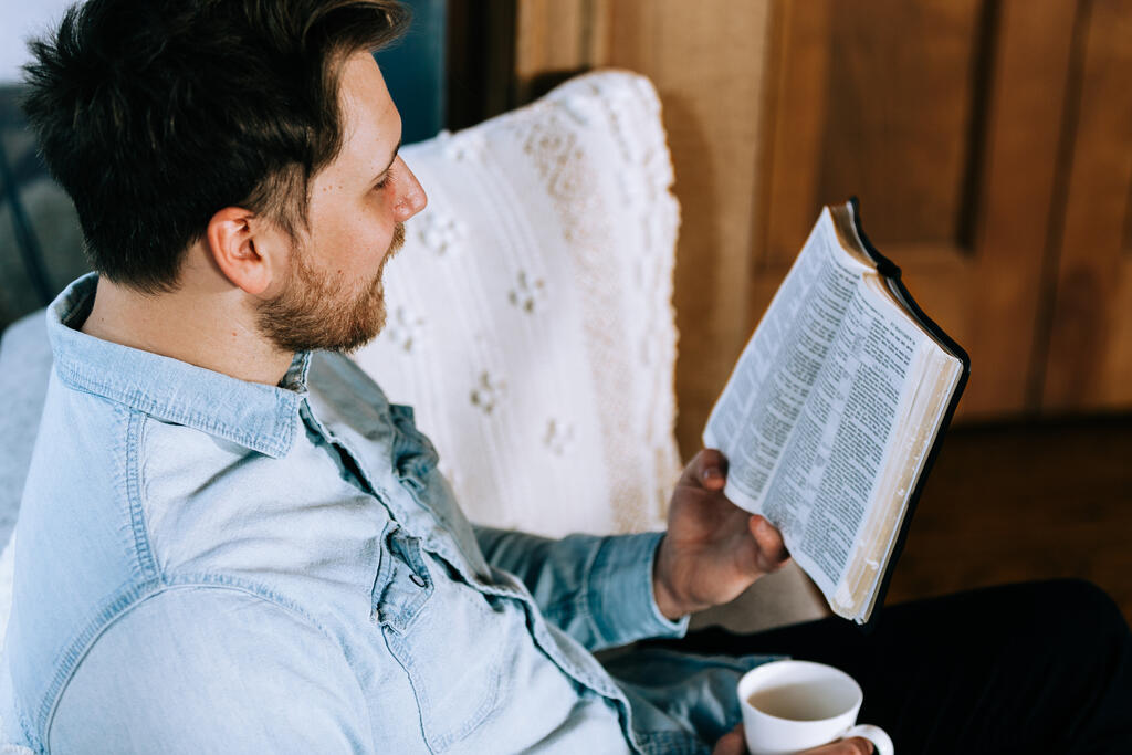 Man Reading the Bible with a Cup of Coffee large preview