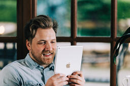 Man Reading on a Tablet  image 2