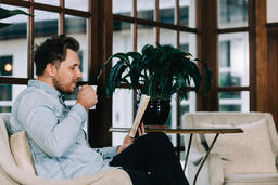 Man Reading the Bible with a Cup of Coffee  image 3