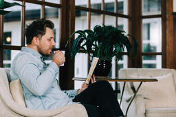 Man Reading the Bible with a Cup of Coffee  image 2