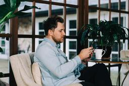 Man Looking at His Phone  image 3