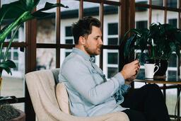 Man Looking at His Phone  image 2