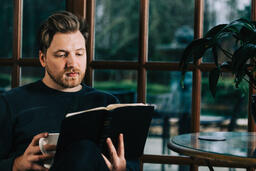 Man Reading the Bible with a Cup of Coffee  image 4