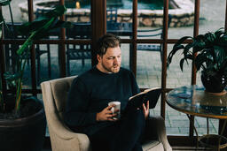 Man Reading the Bible with a Cup of Coffee  image 1