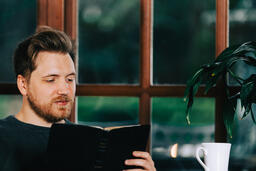 Man Reading the Bible with a Cup of Coffee  image 5