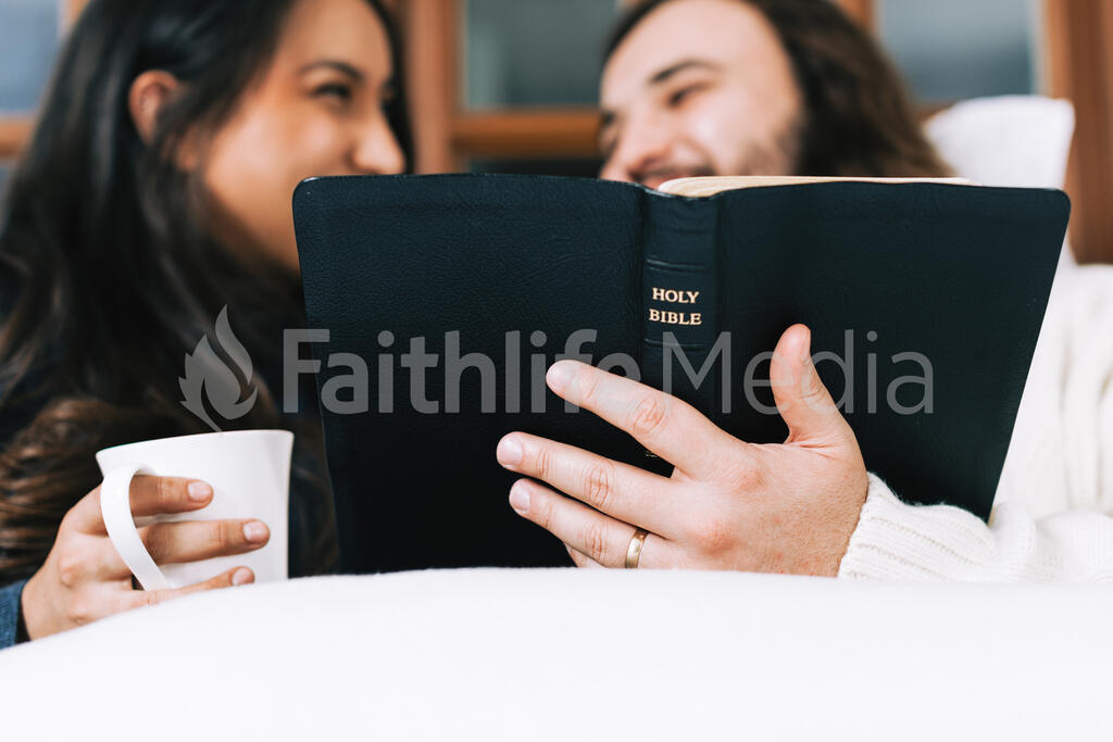 Husband and Wife Reading the Bible Together in Bed large preview