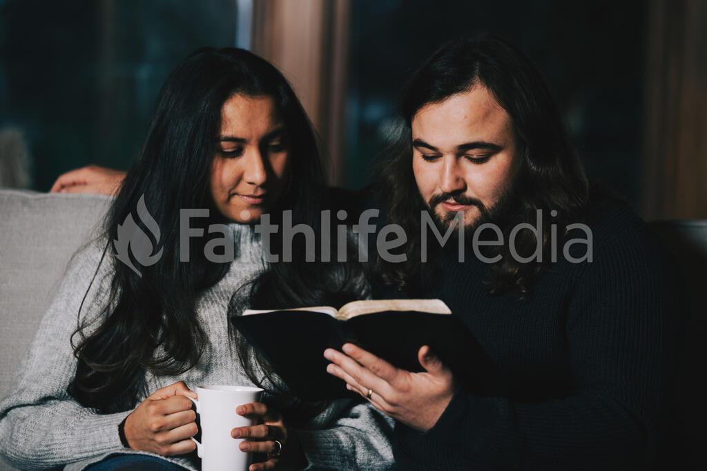 Husband and Wife Reading the Bible Together large preview